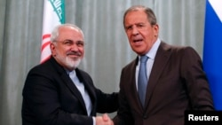 Міністри закордонних справ Ірану Мохаммад Джавад Заріф (ліворуч) і Росії Сергій Лавров під час зустрічі в Москві, серпень 2014 року