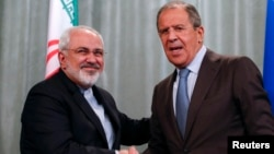 Iranian Foreign Minister Mohammad Javad Zarif (left) met with his Russian counterpart Sergei Lavrov on August 29.