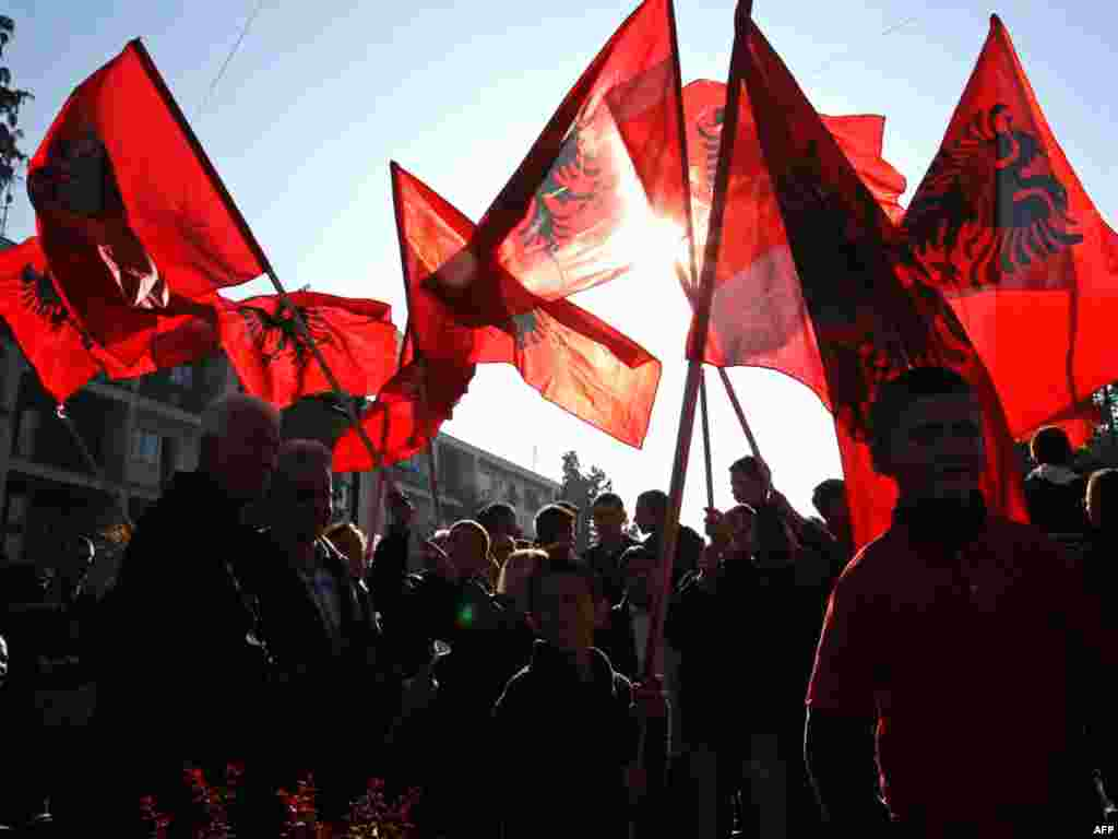 Ethnic Albanians hold Albanian flags in a rally marking Albanian Flag Day in Bujanovac, southern Serbia on November 28. (AFP Photo/Sasa Djordjevic)