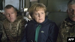 German Chancellor Angela Merkel travels in a helicopter with German troops during a surprise visit to their base in the northern Afghan city of Kunduz in April.