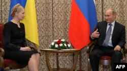Russian Prime Minister Vladimir Putin meets with Ukrainian Prime Minister Yulia Tymoshchenko in Astana on May 22.