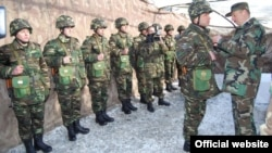Azerbaijan - President Ilham Aliyev (R) awards soldiers serving in Geranboy district, 21Jan2012.