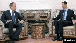 რუსეთის საგარეო საქმეთა მინისტრი სერგეი ლავროვი და სირიის პრეზიდენტი ბაშარ ალ-ასადი
