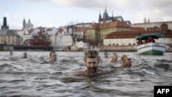 Polar swimmers take part at the New Year swim in the Vltava River in Prague, Czech Republic. AFP PHOTO/MATEJ DIVAZNA