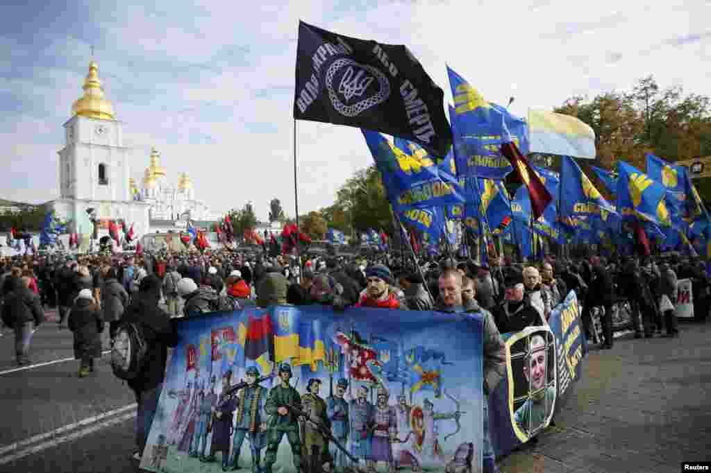 Members of Right Sector  and other far-right Ukrainian groups and their supporters hold a rally to mark Defenders Day, which coincides with the religious feast of the Intercession of the Holy Virgin, in Kyiv on October 14. (Reuters/Gleb Garenich)