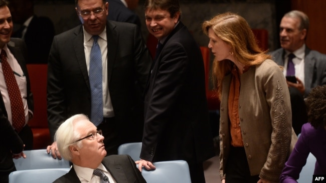 US Ambassador to the UN Samantha Power argues with Churkin prior to a vote on a resolution on Ukraine during a UN Security Council emergency meeting at United Nations headquarters in New York on March 15, 2014.