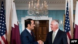 Qatar's Foreign Minister Mohammed bin Abdulrahman al-Thani (L) and US Secretary of State Rex Tillerson before a meeting in Washington, June 27, 2017