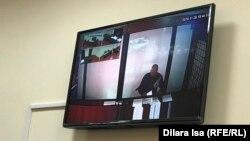 Заключенный Ерлан Балтабай участвует в судебном процессе по видеосвязи. Шымкент, 27 ноября 2019 года.