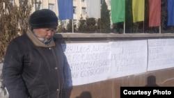 Одна из участниц акции протеста против микрокредитной компании «МФРК» Жылдыз Омуракунова.
