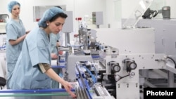 Armenia - Workers at a medical items factory in Yerevan recently set up by a Russian company, 14Mar2014.