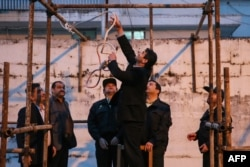 Officials prepare a noose ahead of a public hanging In Iran. Freedom House said their was a significant spike in the number of executions carried out in the Persian Gulf country in 2015. (file photo)