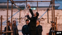 Officials prepare the noose for the execution in Iran.