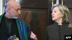 U.S. Secretary of State Hillary Clinton and Afghan President Hamid Karzai at the U.S. State Department on May 11