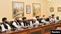 Mullah Abdul Ghani Baradar (third left) leads the Taliban delegation that attended a meeting at the Foreign Affairs Ministry in Islamabad on October 3.