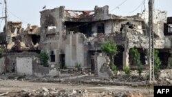 Зруйновані внаслідок боїв між урядовими силами і бойовиками будівлі у місті Рамаді, провінція Анбар, 24 червня 2014 року