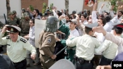 Iran -- Iranian students clash with police and anti-riot forces while trying to attack the British embassy in Tehran, 04Aug2006
