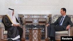 Переговоры президента Сирии Башара Асада (справа) и премьер-министра Катара Шейха Хамада ат-Тани