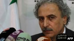 """Лоуей Хуссейн, лидер сирийского движения оппозиции """"Строительство сирийского государства"""", на пресс-конференции. Дамаск, 12 июля 2012 года."""