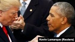 Donald Trump (solda) və Barack Obama 2017-ci ilin yanvarında Trump-ın inaqurasiyasında