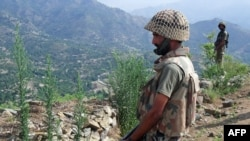 Pakistani Army soldiers patrol the area of Maidan in the district of Lower Dir.