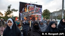 Pakistani Shi'ite Muslims demonstrate over the U.S. air strike in Iraq that killed General Qasim Soleimani, in Islamabad, on January 3.