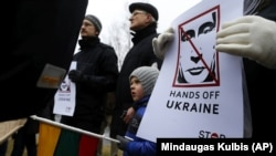 Demonstrators gather outside the Russian Embassy in Vilnius, Lithuania, to protest against Russian intervention in Ukraine in March 2014.