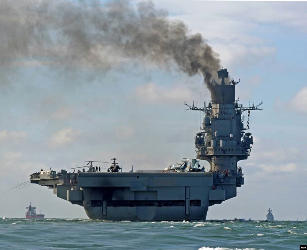 The 305-meter Admiral Kuznetsov passing within sight of the white cliffs of Dover on October 21. The mission to the Syrian coast of the eastern Mediterranean will be the first-ever combat operation for this troubled relic of the Soviet Union.