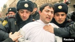 Azerbaijan -- Police detain a protester in Baku, 11Mar2011