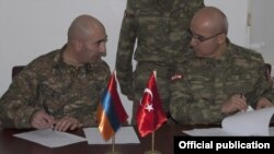 Turkey - Senior Armenian and Turkish army officers sign a protocol, 29Nov2012.