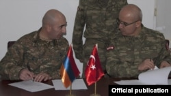Turkey - Senior Armenian and Turkish army officers sign a protocol, 29Nov2012.