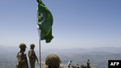 Pakistani soldiers stand guard on top of a mountain overlooking the Swat Valley. Will the government prevent the Taliban from coming back?