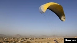 Afghan paraglider Zakia Mohammadi flies in Kabul on September 14.