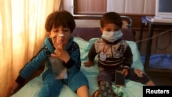 Children receive oxygen, after suffering from choking, at a hospital in Taza, south of Kirkuk, in March. Islamic State militants in parts of occupied Iraq are known to have tried to manufacture chemical weapons.