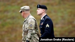 U.S. Army Sergeant Bowe Bergdahl (right) is escorted as he arrives at the courthouse for the start of sentencing proceedings in his court-martial at Fort Bragg, North Carolina, on October 23.