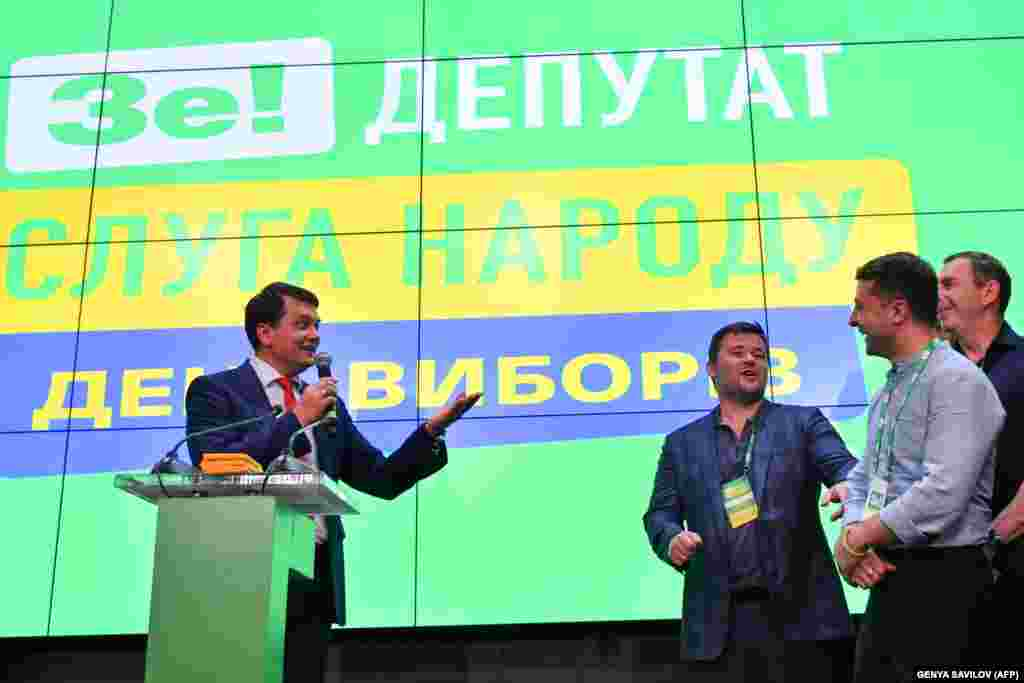 Dmytro Razumkov, head of president Volodymyr Zelenskiy's Servant of the People party, speaks at the party's election headquarters in Kyiv before answering questions from the press. (AFP/Genya Savilov)