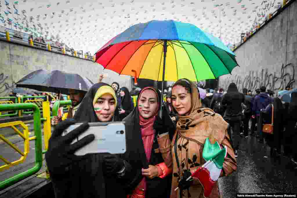 An Iranian woman takes selfies during a ceremony to mark the 40th anniversary of the Islamic Revolution in Tehran on February 11. (Tasnim News/Vahid Ahmadi)