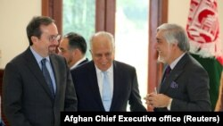 U.S. special representative for Afghanistan Zalmay Khalilzad (center), U.S. Ambassador John Bass and Afghanistan Chief Executive Abdullah Abdullah talk ahead of a meeting in Kabul on October 27.