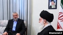 FILE PHOTO - Iranian supreme leader Ayatollah Ali Khamenei meeting with Ismail Haniya (L), Palestinian Hamas leader in Tehran on February 12, 2012.