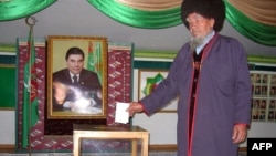 A man casts his ballot in Turkmenistan's parliamentary elections on December 14.
