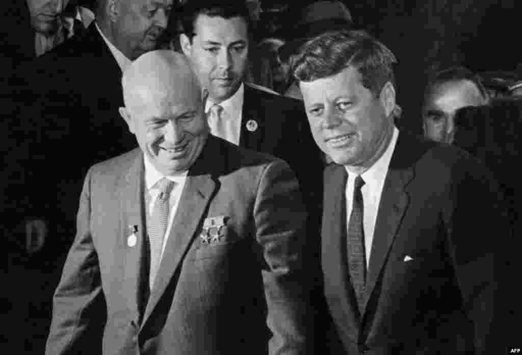 President Kennedy and Soviet leader Nikita Khrushchev head to their first meeting in June 1961 to start a round of talks in Vienna. This was a year before the beginning of the Cuban missile crisis, during which Kennedy ordered a blockade of Cuba after the Soviet Union began to transport missiles to the island.