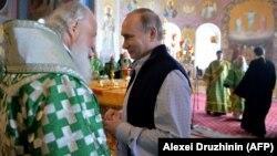 Патриарх Московский и всея Руси Кирилл и президент России Владимир Путин.