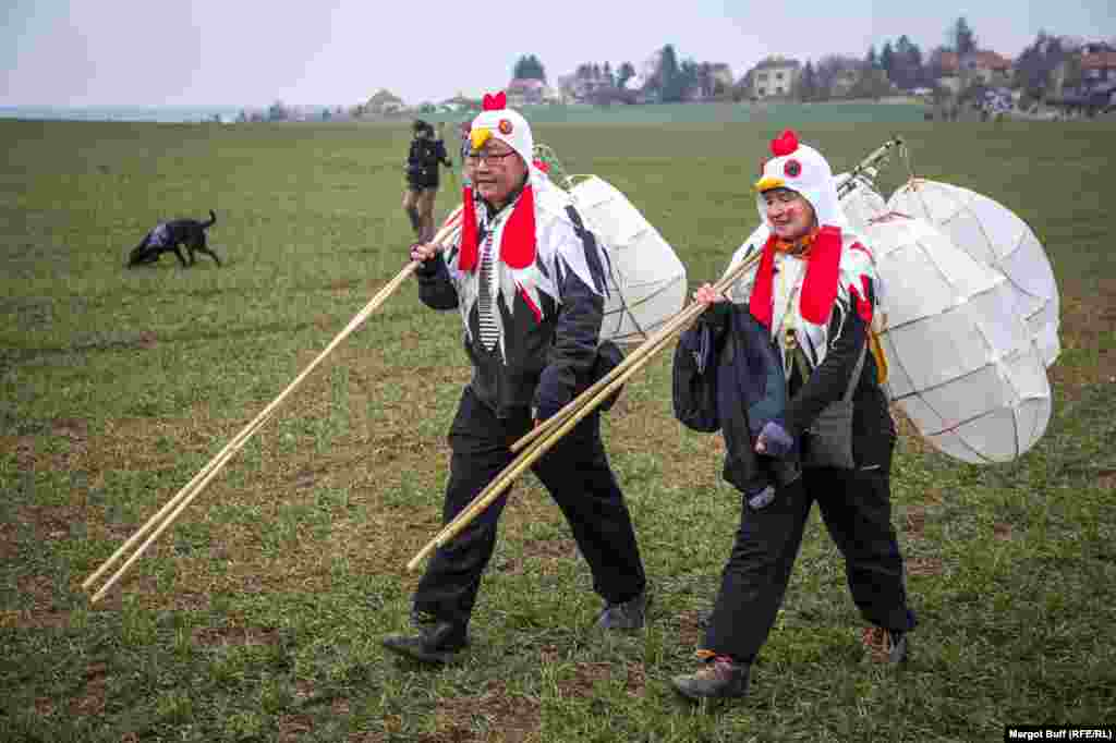 Weary chickens make their way into the countryside outside Roztoky as the parade continues toward sundown.