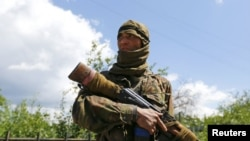 Uzbekistan - Armed pro-Russian separatist Bakhtiyar, who is from Uzbekistan, looks on in a street in Seversk, Donetsk region