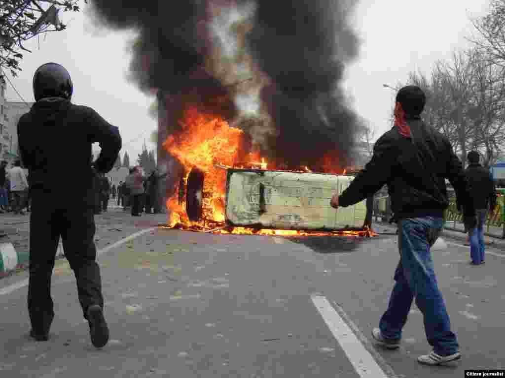 Iran -- Iranian protestors set fire on a police car during demonstrations against President Mahmud Ahmadinejad in Tehran, 27Dec2009
