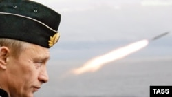 Vladimir Putin watching naval exercises during his last term as president in 2005