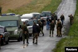 Echipa OSCE în apropiere de Grabovo, locul prăbușirii avionului