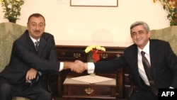 Azerbaijani President Ilham Aliyev (left) and Armenian President Serzh Sarkisian meet on the sidelines of a CIS summit in Chisinau in October 2009.