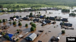 Затопленное село в Иркутской области, Сибирь, Россия, 26 июня 2019 года