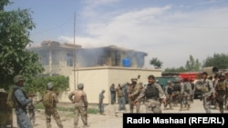 Security forces surround the provincial justice department in Jalalabad.