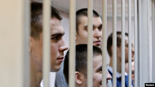 Defendants in the Bolotnaya case wait for their sentencing in a holding cell during a court hearing in Moscow on February 24.